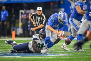 Detroit Lions quarterback Matthew Stafford (9) is stripped of the ball by Seattle Seahawks defensive tackle Jarran Reed (90)