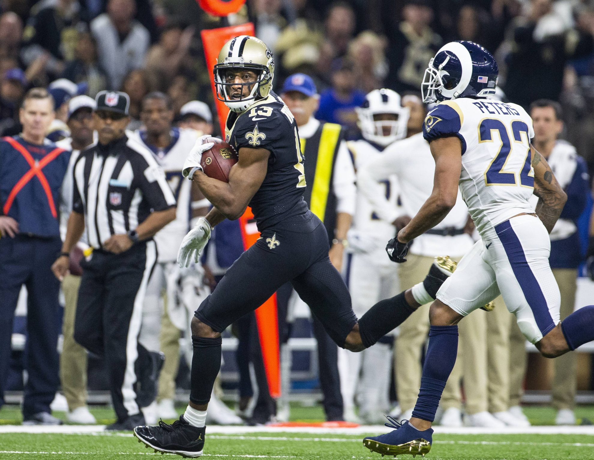 New Orleans Saints wide receiver Michael Thomas 13 looks over his shoulder at Los Angeles Rams cor