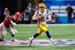 LSU s Joe Burrow 9 scrambles during the Chick-Fil-A Peach Bowl - a College Football Playoff Nationall Semifinal - featuring the Oklahoma Sooners and the LSU Tigers, played at Mercedes Benz Stadium in Atlanta, Georgia. /CSM NCAA, College League, USA Football 2019