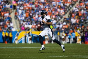 LOS ANGELES, CA - OCTOBER 06: Denver Broncos quarterback Joe Flacco (5) rolls out to pass during the NFL, American Footb