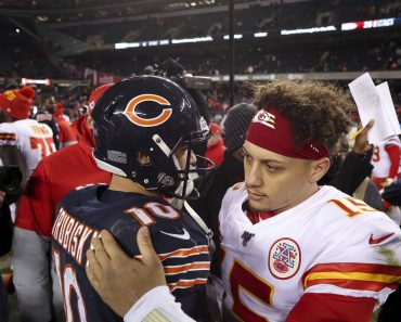 December 22, 2019, Chicago, IL, USA: Chicago Bears quarterback Mitch Trubisky hugs Kansas City Chiefs quarterback Patric