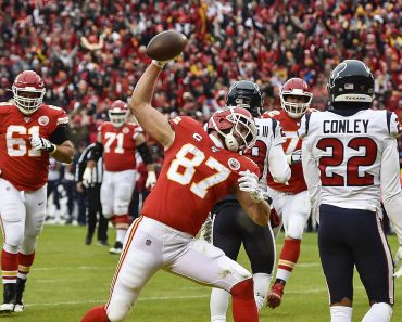 January 12, 2020, Kansas City, MO, USA: Kansas City Chiefs tight end Travis Kelce spikes the ball after scoring his firs