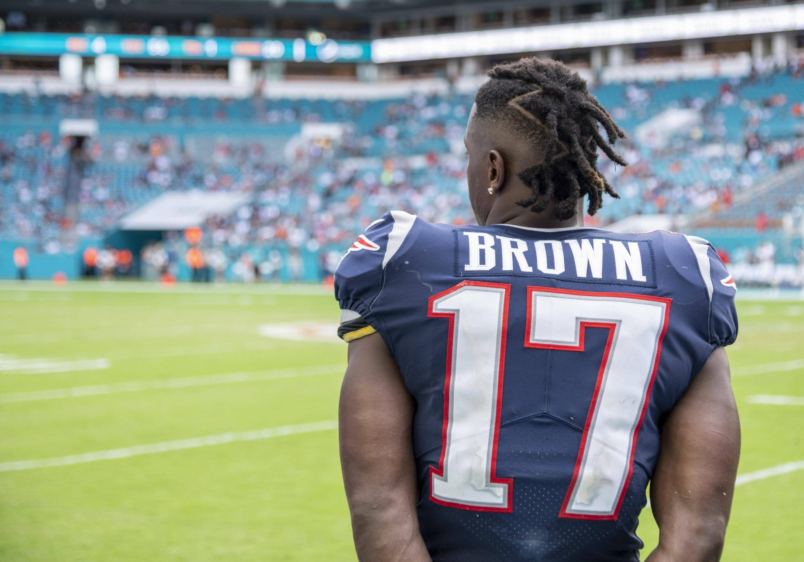MIAMI GARDENS, FL - SEPTEMBER 15: New England Patriots Wide Receiver Antonio Brown (17) watches the game on the sidelin
