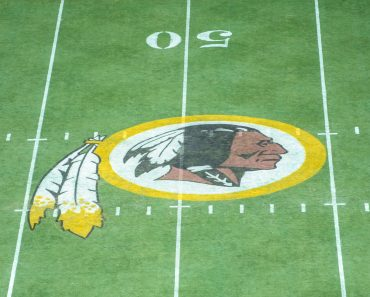 SEP 14 2014 The Redskins logo on the center of the field during the season opening matchup of the