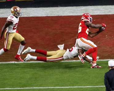 (200203) -- MIAMI, Feb. 3, 2020 -- Kansas City Chiefs player Damien Williams (1st R) scores a touchdown during the NFL,