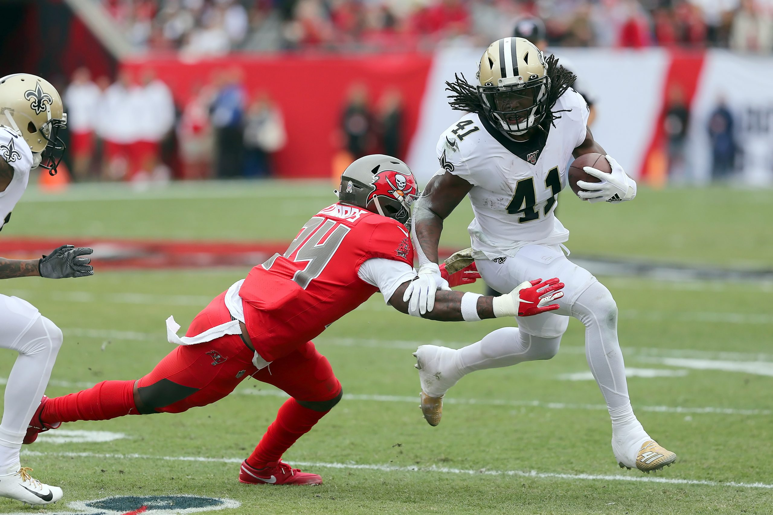 TAMPA, FL - NOV 17: Mike Edwards (34) of the Bucs attempts to wrap up Alvin Kamara (41) of the Saints during the regular