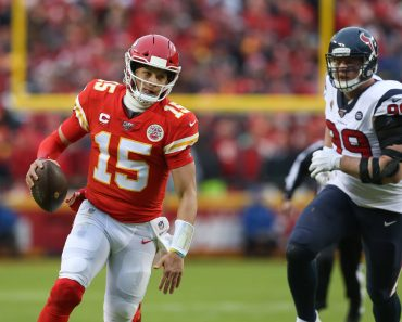 KANSAS CITY, MO - JANUARY 12: Kansas City Chiefs quarterback Patrick Mahomes (15) runs past Houston Texans defensive en