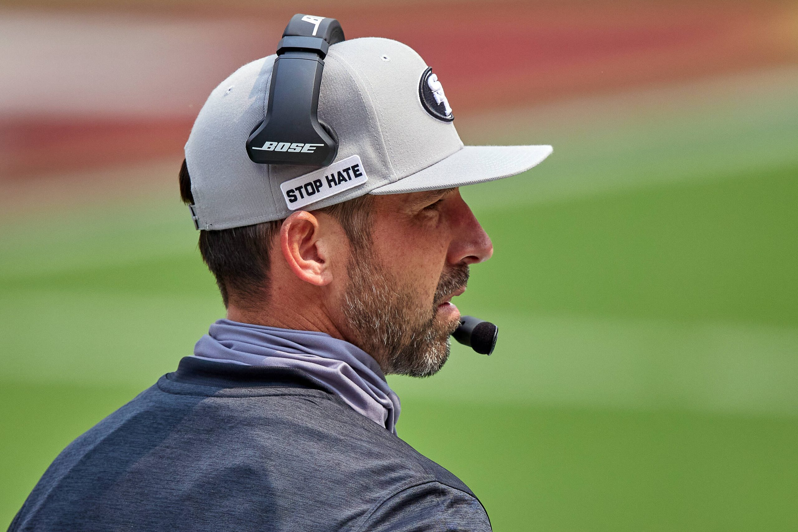 SAN FRANCISCO, CA - SEPTEMBER 13: San Francisco 49ers head coach Kyle Shanahan talks into his headset during the NFL, Am