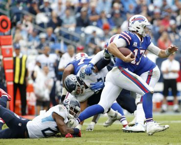 NASHVILLE, TN - OCTOBER 06: Buffalo Bills quarterback Josh Allen (17) escapes a tackle of Tennessee Titans cornerback Ma