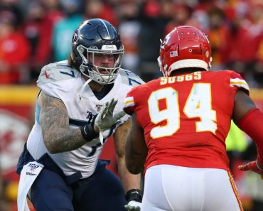 KANSAS CITY, MO - JANUARY 19: Tennessee Titans offensive tackle Taylor Lewan (77) blocks Kansas City Chiefs outside line