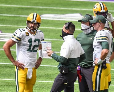 MINNEAPOLIS, MN - SEPTEMBER 13: Green Bay Packers Quarterback Aaron Rodgers (12) talks with Green Bay Packers Head Coach