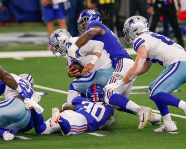 ARLINGTON, TX - OCTOBER 11: Dallas Cowboys Quarterback Dak Prescott (4) is sacked by New York Giants Linebacker Markus G