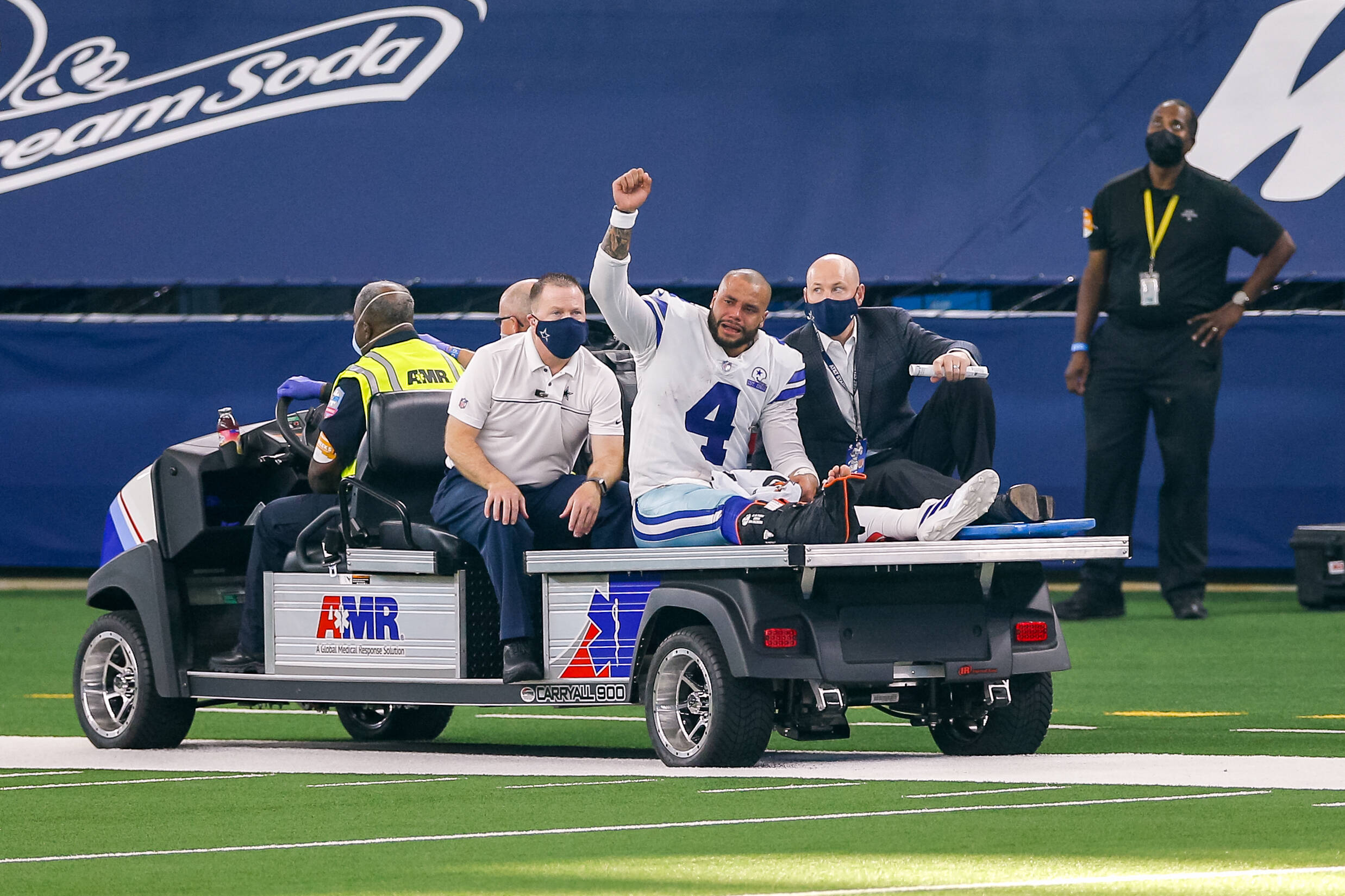 ARLINGTON, TX - OCTOBER 11: Dallas Cowboys Quarterback Dak Prescott (4) is carted off the field after suffering a leg i