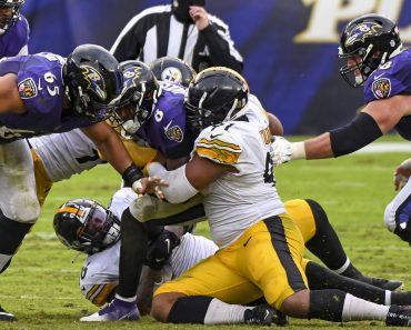 BALTIMORE, MD - NOVEMBER 01: Baltimore Ravens quarterback Lamar Jackson (8) is sacked by Pittsburgh Steelers defensive e