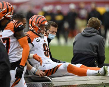 LANDOVER, MD - NOVEMBER 22: Joe Burrow (9) reacts as he is carted off the field after being injured during the Cincinna