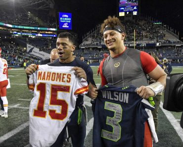 December 23, 2018 - Seattle, WA, USA - Seattle Seahawks quarterback Russell Wilson, left, and Kansas City Chiefs quarte