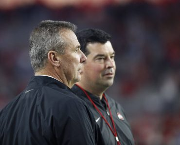 December 28, 2019 Former Ohio State coach Urban Meyer with Ohio State Buckeyes head coach Ryan Day in action during the