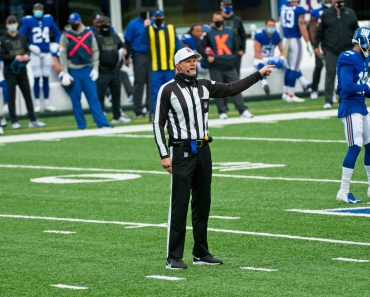 EAST RUTHERFORD, NJ - NOVEMBER 15: Referee Clay Martin (19) makes a call during the game between the Philadelphia Eagles