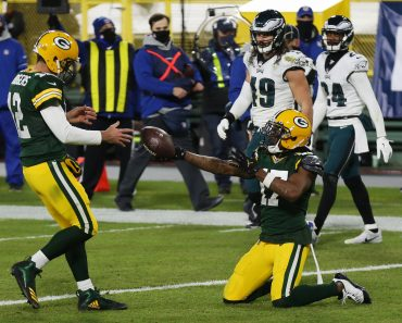 Aaron Rodgers KW49 GREEN BAY, WI - DECEMBER 06: Green Bay Packers wide receiver Davante Adams (17) hands the