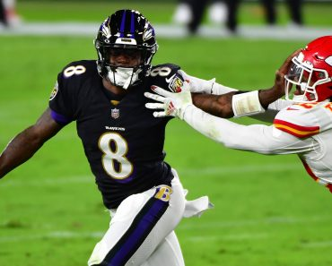 Baltimore Ravens quarterback Lamar Jackson (8) pushes Kansas City Chiefs safety Juan Thornhill (22) away during the firs