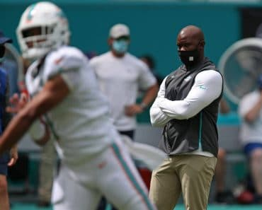 October 4, 2020, USA: Miami Dolphins coach Brian Flores watches quarterback Tua Tagovailoa warm up before their game aga