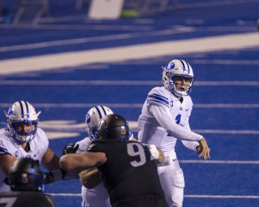 November 6, 2020, Boise, ID, USA: BYU quarterback Zach Wilson, right, has plenty of time to pass with his offensive line
