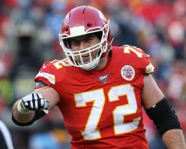 KANSAS CITY, MO - JANUARY 19: Kansas City Chiefs offensive tackle Eric Fisher (72) looks to fist bump a teammate in the