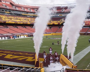 The Washington Football Team takes the field to an empty stadium for their game against the Philadelphia Eagles at FedE