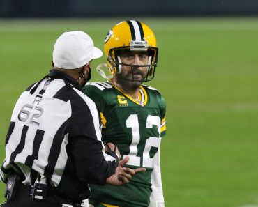 GREEN BAY, WI - JANUARY 16: Green Bay Packers quarterback Aaron Rodgers (12) gets an explanation from referee Ron Torber