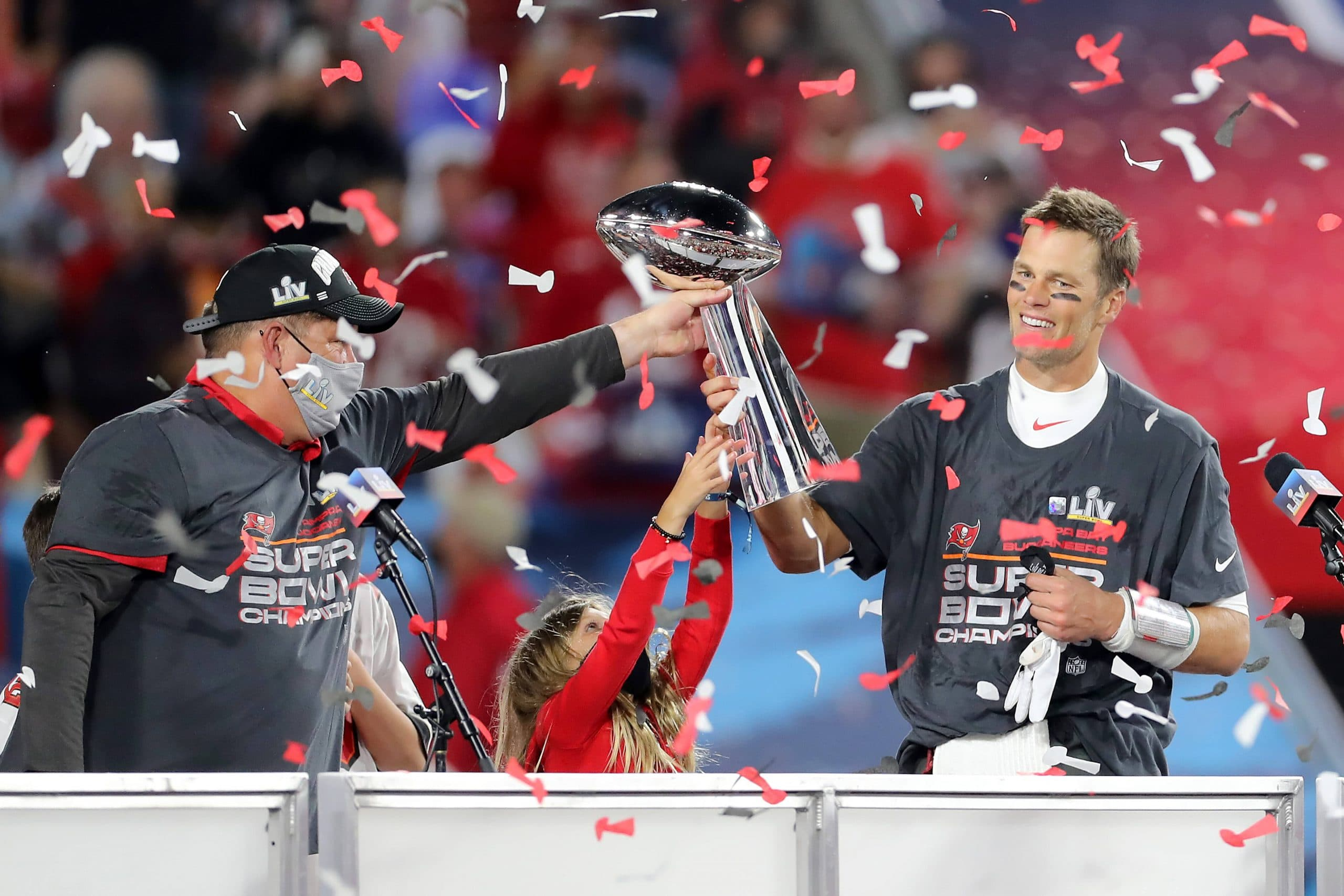 TAMPA, FL - FEBRUARY 07: Super Bowl MVP Tom Brady (12) of the Buccaneers accepts the Lombardi Trophy from General Manage