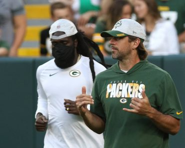 GREEN BAY, WI - AUGUST 14: Green Bay Packers quarterback Aaron Rodgers (12) comes out for the game during a game betwee