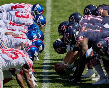 CHICAGO, IL - SEPTEMBER 20: The Chicago Bears offensive line lines up across the New York Giants defensive line at the l