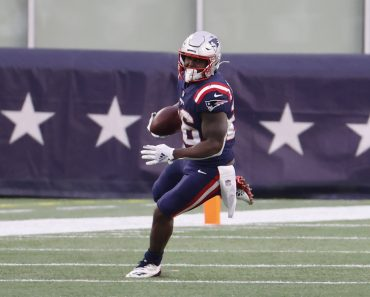 FOXBOROUGH, MA - JANUARY 03: New England Patriots running back Sony Michel (26) gets to the outside during a game betwee