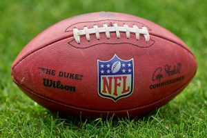 CHICAGO, IL - AUGUST 21: A detail view of the NFL, American Football Herren, USA crest logo is seen on a Wilson football