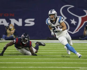 HOUSTON, TX - SEPTEMBER 23: Carolina Panthers running back Christian McCaffrey (22) evades a tackle by Houston Texans in
