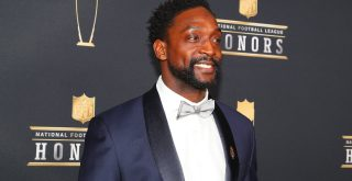 MINNEAPOLIS MN FEBRUARY 03 Charles Tillman poses for Photographs on the Red Carpet at NFL Americ