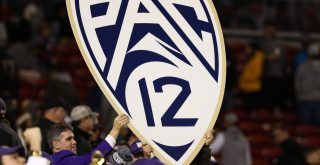 December 2 2016 Members of the Washington Huskies marching band hold up a Pac 12 logo sign during