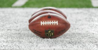 August 19 2016 The practice footballs sit on the field during an NFL American Football Herren USA