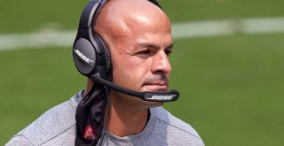 SAN FRANCISCO, CA - SEPTEMBER 13: San Francisco 49ers defensive coordinator Robert Saleh talks into his Bose radio heads