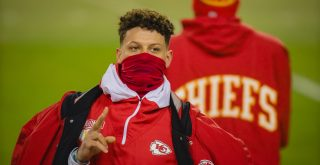 Kansas City Chiefs quarterback Patrick Mahomes (15) acknowledges the fans while resting against the Los Angeles Chargers