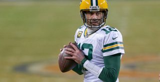 CHICAGO, IL - JANUARY 03: Green Bay Packers quarterback Aaron Rodgers (12) handles the football in action during a game