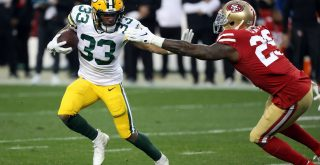 SANTA CLARA, CA - JANUARY 19: Green Bay Packers Running Back Aaron Jones rushes with the ball during an NFC Conference C