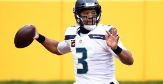 Seattle Seahawks quarterback Russell Wilson (3) looks to pass againt the Washington Football Team at FedEx Field in Lan