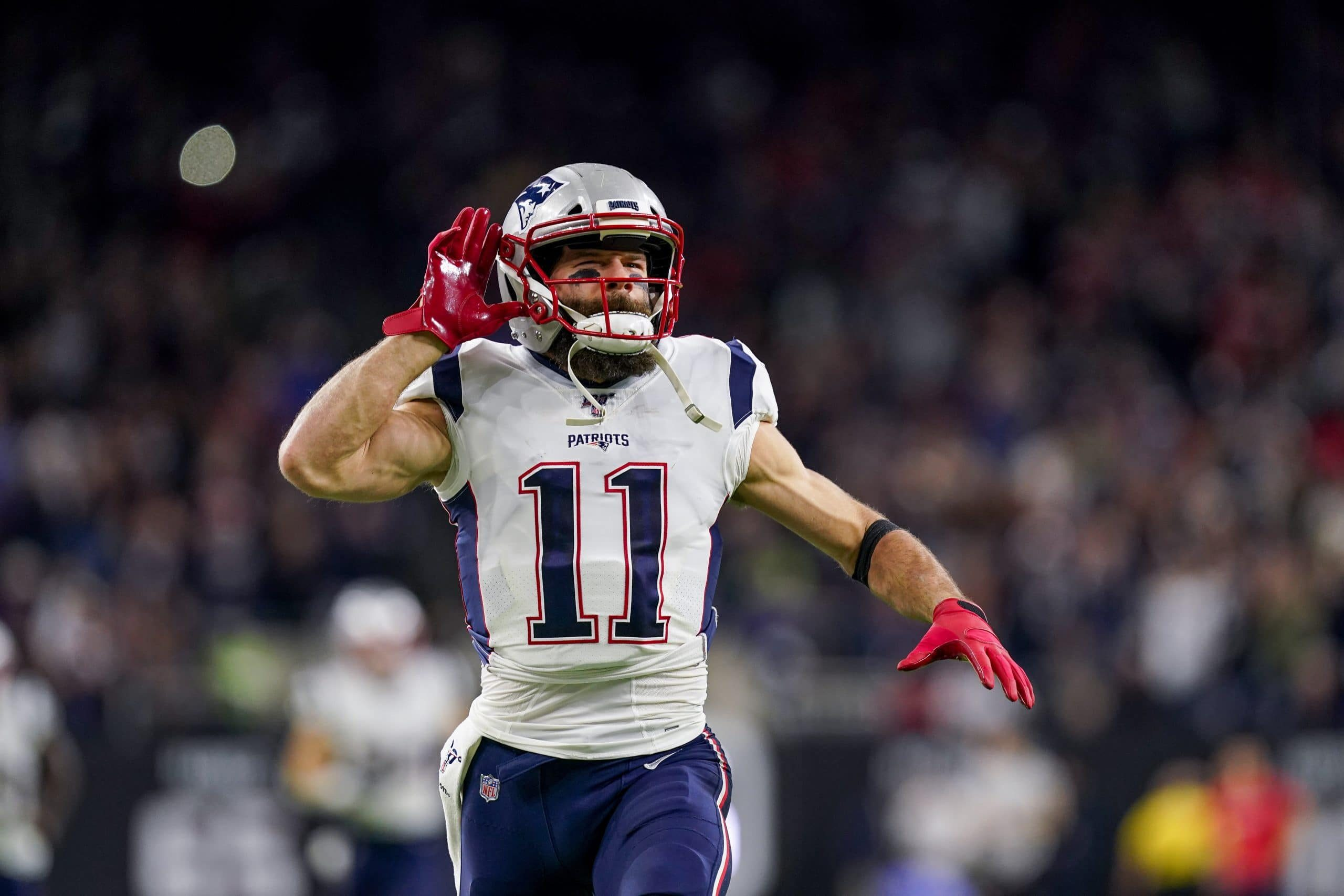 HOUSTON, TX - DECEMBER 01: New England Patriots wide receiver Julian Edelman (11) runs onto the field before the game be