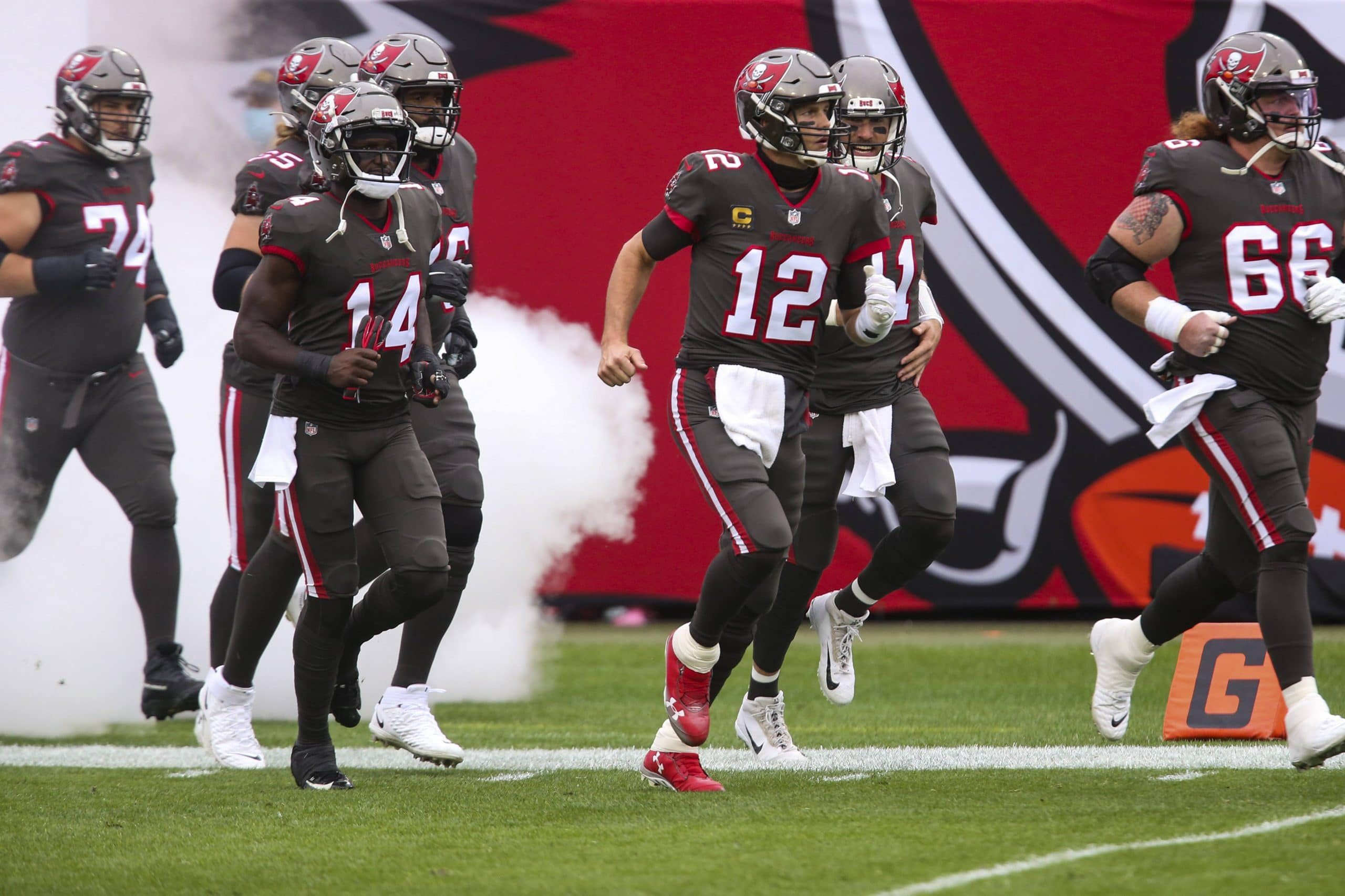 January 3, 2021, Tampa, Florida, USA: Tampa Bay Buccaneers quarterback Tom Brady (12) makes his way to the field during